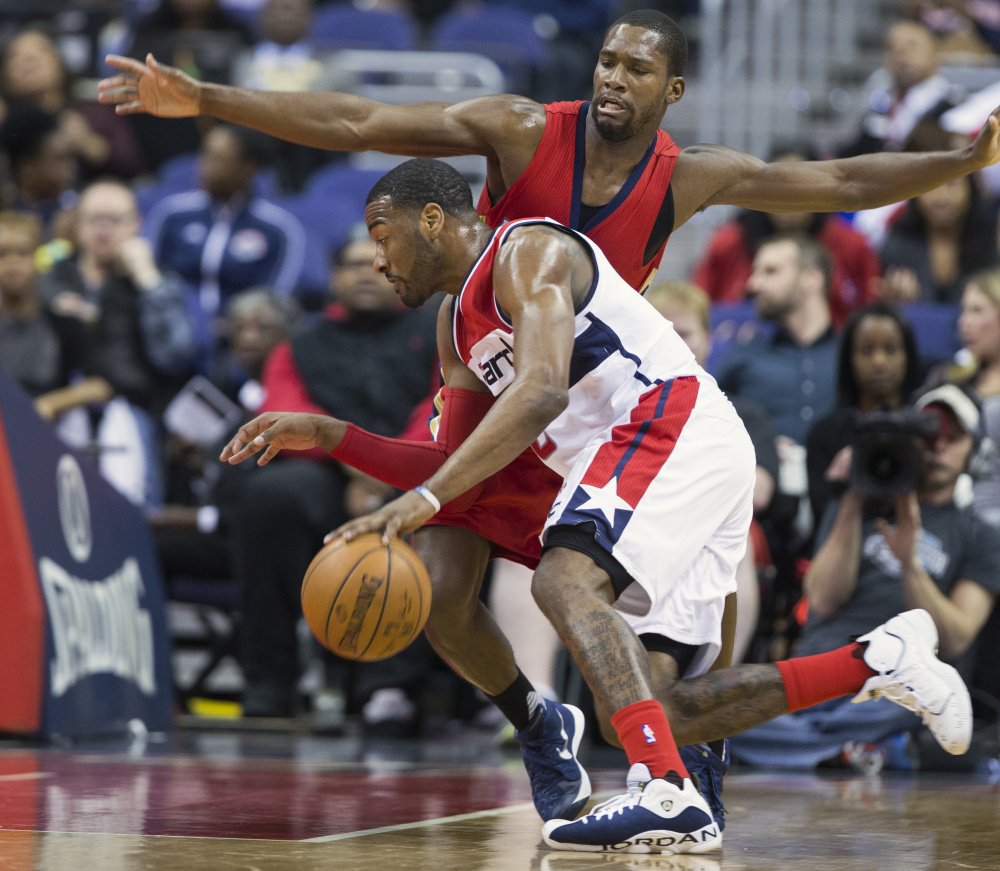 John Wall of the Washington Wizards looks to drive past Toney Douglas of the New Orleans Pelicans on Tuesday.