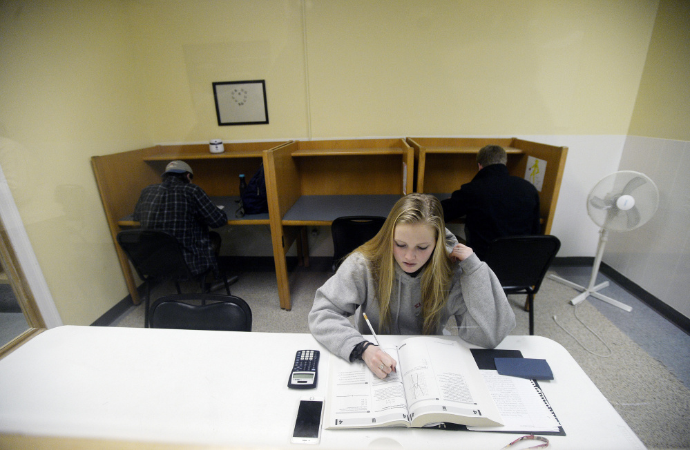"""Scarborough High School junior Rachel Barr, 17, sits for a preparatory SAT exam with other students at The Study Hall in Scarborough this week. Barr had already prepped for the old test but welcomes the changes in the revised version. """"I've never been a fan of geometry,"""" she said, """"so I'm glad there's less."""""""