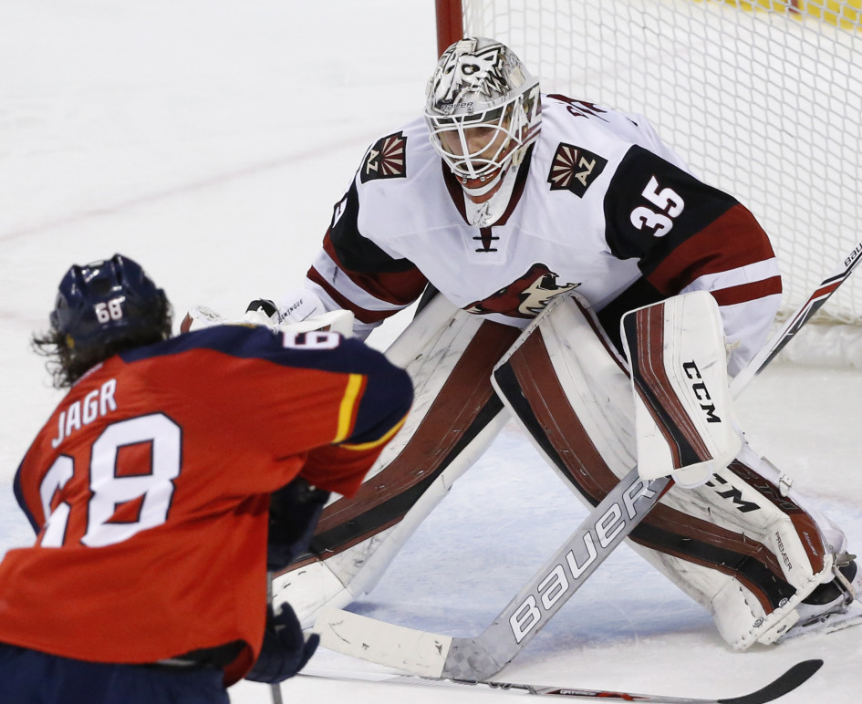 Panthers right wing Jaromir Jagr attempts a shot against Arizona Coyotes goalie Louis Domingue, a former Portland Pirate, during the second period of Florida's 3-2 win at Sunrise, Florida, on Thursday night. Domingue made 21 saves.
