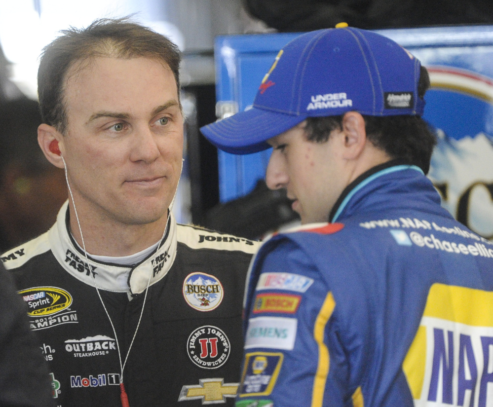 Kevin Harvick, left, and Chase Elliott talk during practice for Sunday's Sprint Cup race in Georgia. Harvick spoke Friday about Stewart-Haas Racing's surprising move to Ford in 2017.