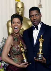 "Halle Berry and Denzel Washington celebrate their best actress and actor Oscars for, respectively, ""Monster's Ball"" and ""Training Day"" at the 2002 Academy Awards."