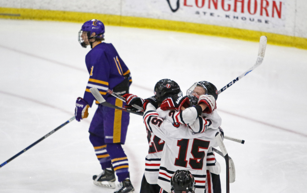 Scarborough celebrates a third-period goal by Skylar Pettingill (16) during Saturday's Class A South semifinal in Lewiston. The Red Storm beat Cheverus 4-1.