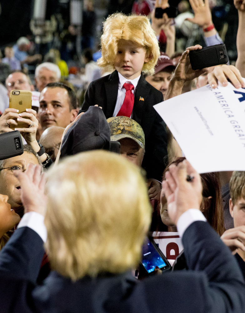Donald Trump gestures to Colton Jordan, 5, following a rally in Valdosta, Ga., Monday. Trump's speech was interrupted by Black Lives Matter and immigration protesters.