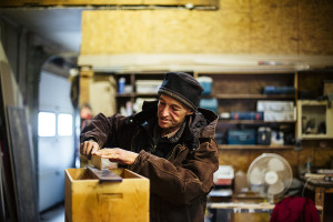 David Moses Bridges works in a new woodworking space on a model of a birch canoe at Leddy-Houser wood shop in South Portland. Whitney Hayward/Staff Photographer