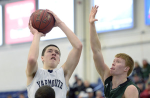 Yarmouth's Nolan Hagerty shoots over Spruce Mountain's Caulin Parker during tournament action at the expo Saturday. Shawn Patrick Ouellette/Staff Photographer