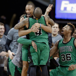 Boston Celtics' Avery Bradley, top, and Isaiah Thomas hug after the Celtics defeated the Cleveland Cavaliers 104-103 Friday in Cleveland. Bradley made a corner jumper at the horn to give the Celtics the win.