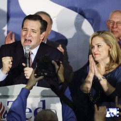 Republican presidential candidate, Sen. Ted Cruz, R-Texas, speaks during a caucus night rally as his wife, Heidi, listens Monday in Des Moines, Iowa. The Associated Press