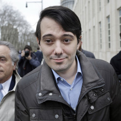 Former Turing Pharmaceuticals CEO Martin Shkreli leaves court with his lawyer, Benjamin Brafman, left, Wednesday in New York. The Associated Press