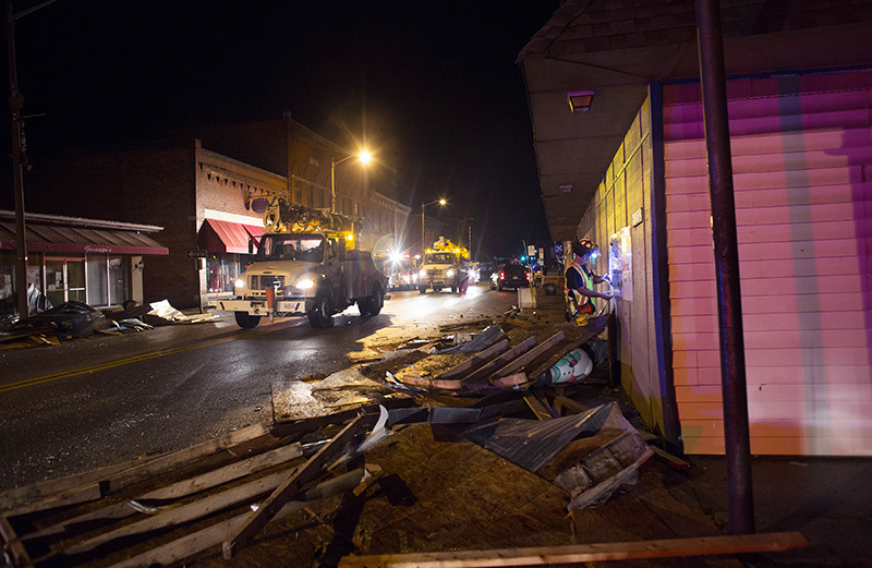 Utility trucks make their way down West Main street in Waverly, Va.,, after it was hit by a tornado earlier in the day on Wednesday.