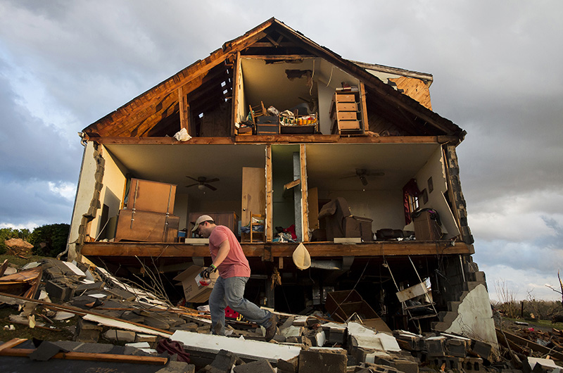 Nick Mobley helps clean up a house owned by a family friend on Wednesday, after a storm hit Appomattox County, Va.