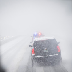 The motorcade of Democratic presidential candidate Sen. Bernie Sanders, I-Vt., drives through a snowstorm on Interstate 93, Friday in Manchester, N.H. What started off as rain Friday morning quickly turned to sticky, heavy snow. The Associated Press