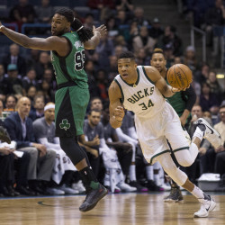 Milwaukee's Giannis Antetokounmpo steals a pass intended for Boston's Jae Crowder during the first half Tuesday.   The Associated Press