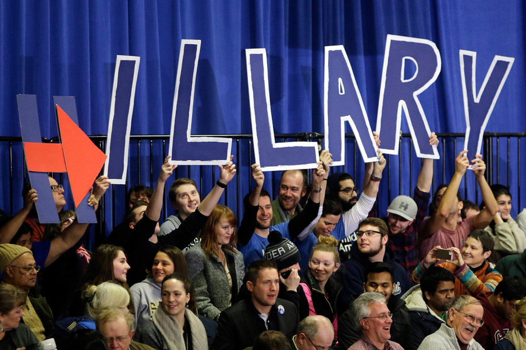 Supporters of Hillary Clinton hold signs spelling out her name at her campaign rally Tuesday in Hooksett, N.H.