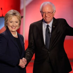 Democratic presidential candidates Hillary Clinton and Bernie Sanders shake hands at the start of their debate Thursday night at the University of New Hampshire. The primary campaign is hotly contested, after a near-tie Monday in the Iowa caucuses. The Associated Press