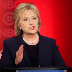 "Hillary Clinton makes her opening statement in Thursday night's debate in Durham, N.H. She later told Bernie Sanders, ""It's time to end the very artful smear that you and your campaign have been carrying out."" The Associated Press"