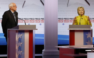 Hillary Clinton makes a point as Bernie Sanders listens during Thursday night's Democratic presidential debate at the University of Wisconsin-Milwaukee. The Associated Press