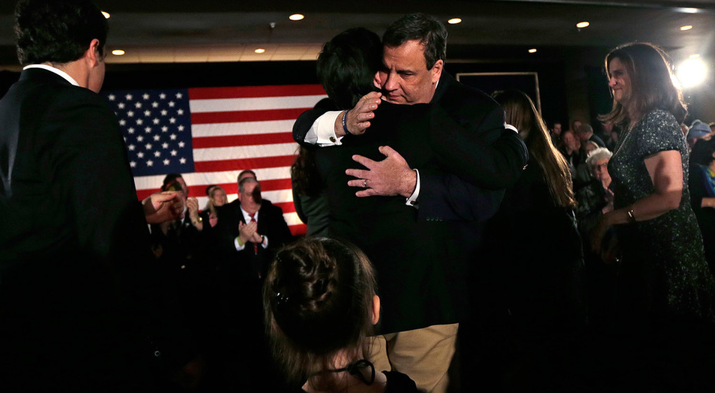 Republican Chris Christie embraces his son Patrick during a primary night rally in Nashua, N.H. Christie's finish back in the pack raised doubts about his campaign's future.