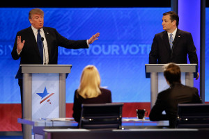 Republican presidential candidate, businessman Donald Trump answers a question as Republican presidential candidate, Sen. Ted Cruz, R-Texas, listens during a Republican presidential primary debate hosted by ABC News at the St. Anselm College on  Saturday in Manchester, N.H.