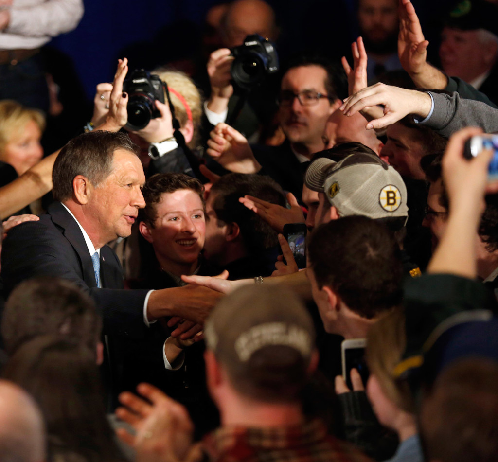 Republican John Kasich reaches out to shake hands with supporters Tuesday in Concord, N.H., after finishing second.