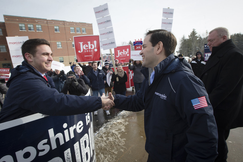 Republican presidential candidate, Sen. Marco Rubio, R-Fla., right, greets a supporter as he visits a polling site at Bedford High School, Tuesday in Bedford, N.H. The Associated Press