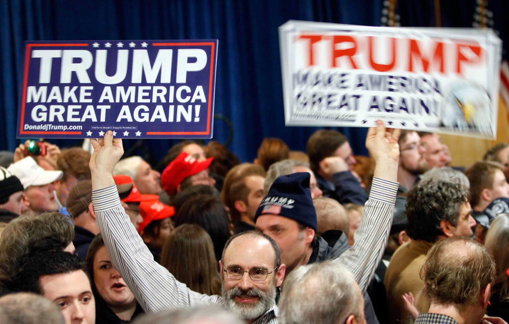 Supporters wait for Donald Trump to speak during a primary night rally in Manchester, N.H.