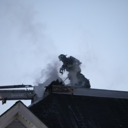 Firefighters battle a blaze at 434 Forest Ave. in Portland on Sunday.  Jill Brady/Staff Photographer