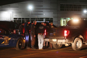 Police meet early Sunday at Kalamazoo Valley Community College after searching for a gunman involved in multiple shootings Saturday in Kalamazoo, Mich. The Associated Press/Mark Bugnaski/Kalamazoo Gazette