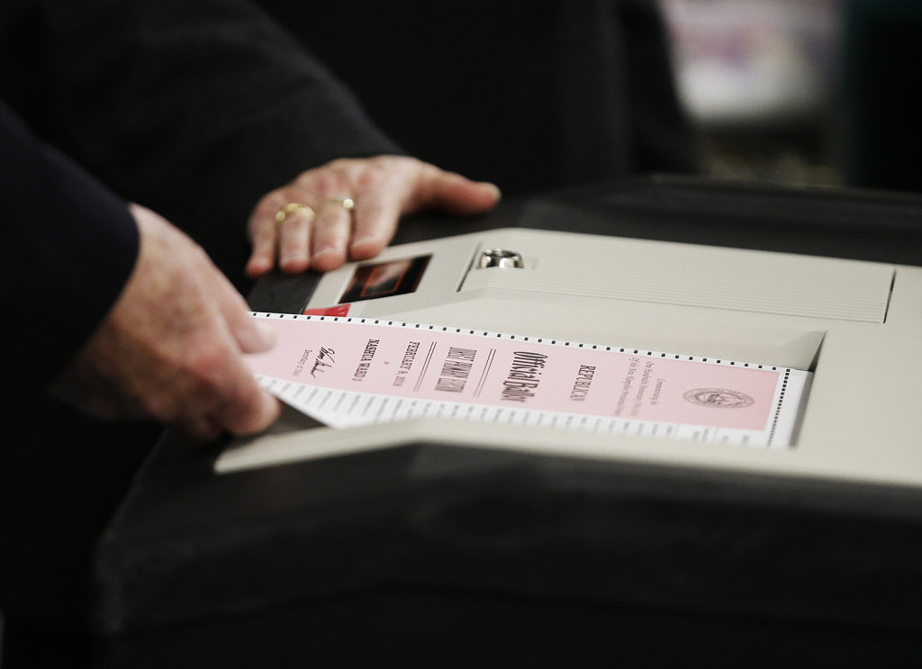 A ballot for the New Hampshire primary is entered into a machine at a polling site Tuesday, in Nashua, N.H. The Associated Press