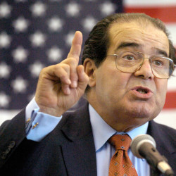 In this April 7, 2004, photo, U.S. Supreme Court Justice Antonin Scalia speaks to Presbyterian Christian High School students in Hattiesburg, Miss.