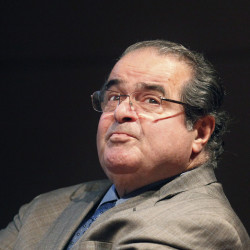 U.S. Supreme Court justice Antonin Scalia looks into the balcony before addressing the Chicago-Kent College of Law in Chicago in this Oct. 18, 2011, photo. The Associated Press