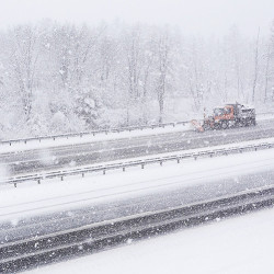 A plow removes snow from the southbound lanes of Interstate 95 in Scarborough on Friday.