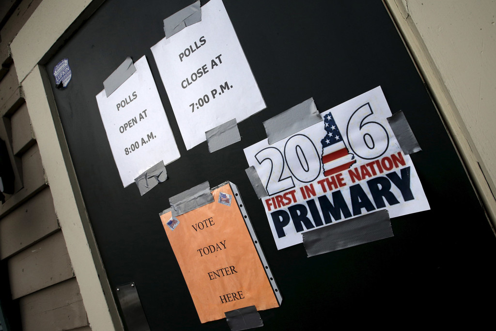 Signs for voters are displayed at a polling station during voting in Tuesday's presidential primary in Groveton, New Hampshire. Reuters/Mike Segar