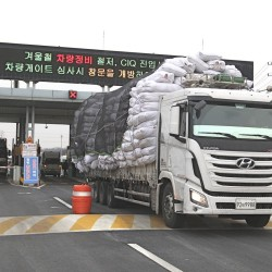 A South Korean cargo truck returning from North Korea's joint Kaesong Industrial Complex passes the customs, immigration and quarantine office near the border village of Panmunjom, in Paju, South Korea, Thursday. The Associated Press