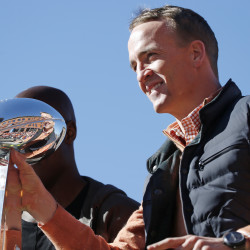 Denver Broncos quarterback Peyton Manning holds the Lombardi Trophy during a parade for the NFL football Super Bowl champions, Tuesday.