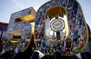 A sign for fisherman's warf is framed by a Super Bowl 50 Thursday, Feb. 4, in San Francisco. The Associated Press