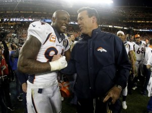 Denver Broncos DeMarcus Ware (94) and Denver Broncos head coach Gary Kubiak celebrate after their win against the Carolina Panthers, 24-10. The Associated Press