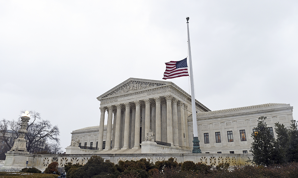 The flag flies at half-staff outside the Supreme Court in Washington following the death of  Justice Antonin Scalia over the weekend. The Associated Press