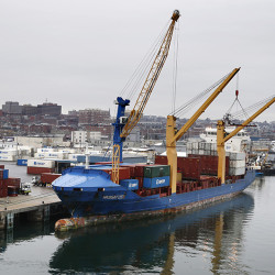 FILE - In this Friday, Jan. 29, 2016, file photo, an Icelandic cargo ship is loaded with containers in Portland, Maine. On Friday, Feb. 5, the Commerce Department reports on the U.S. trade gap for December. (AP Photo/Robert F. Bukaty, File)
