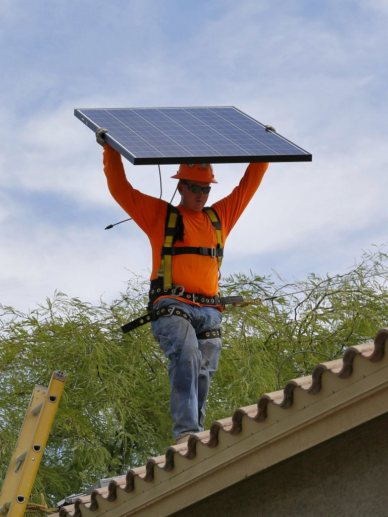 A reader from Falmouth says he had 16 solar panels installed on his house and his  electricity bill fell to about $8 a month in the summer. 2015 Associated Press file photo