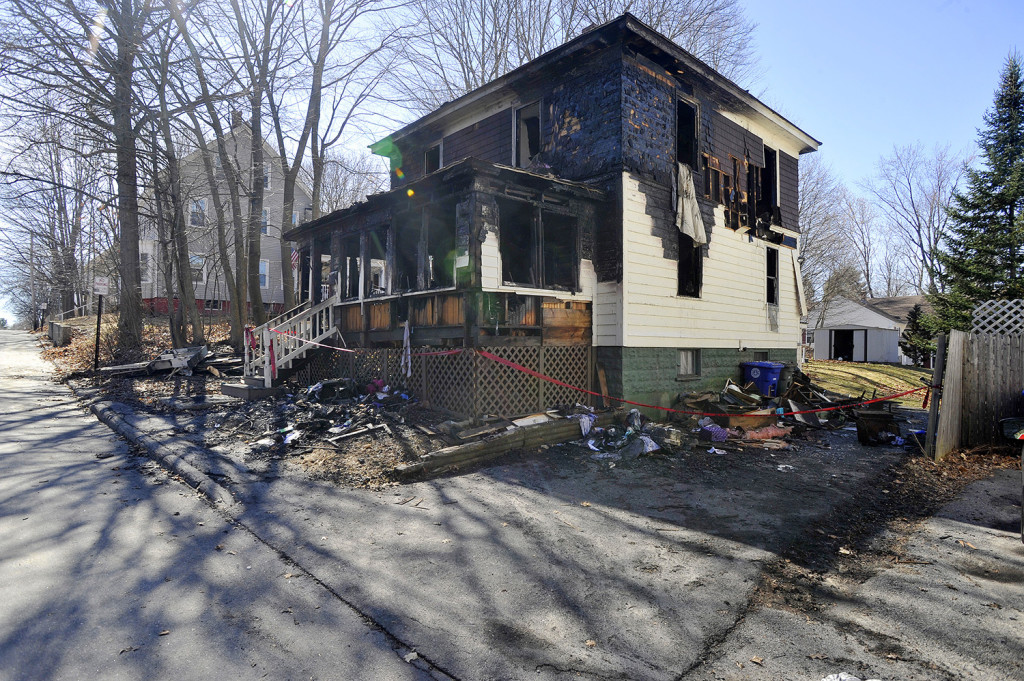 The scene of a house fire at 137 Brackett St. in Westbrook  JohnEwing/Staff Photographer