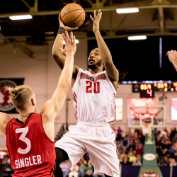 Red Claws guard Levi Randolph drives around Rapters 905 forward E.J. Singler for a basket in the final seconds of the first half.