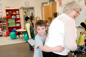 Duncan Blanchard hugs his grandmother Rosanne Mapp after she brought a frog cut out of a watermelon to his classroom at Kennebunk Elementary School to celebrate Duncan's leap-year birthday. Gregory Rec/Staff Photographer