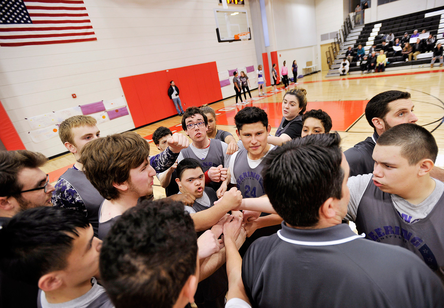 The Portland/Deering Unified Basketball team huddles up at the start of their game against Lisbon.