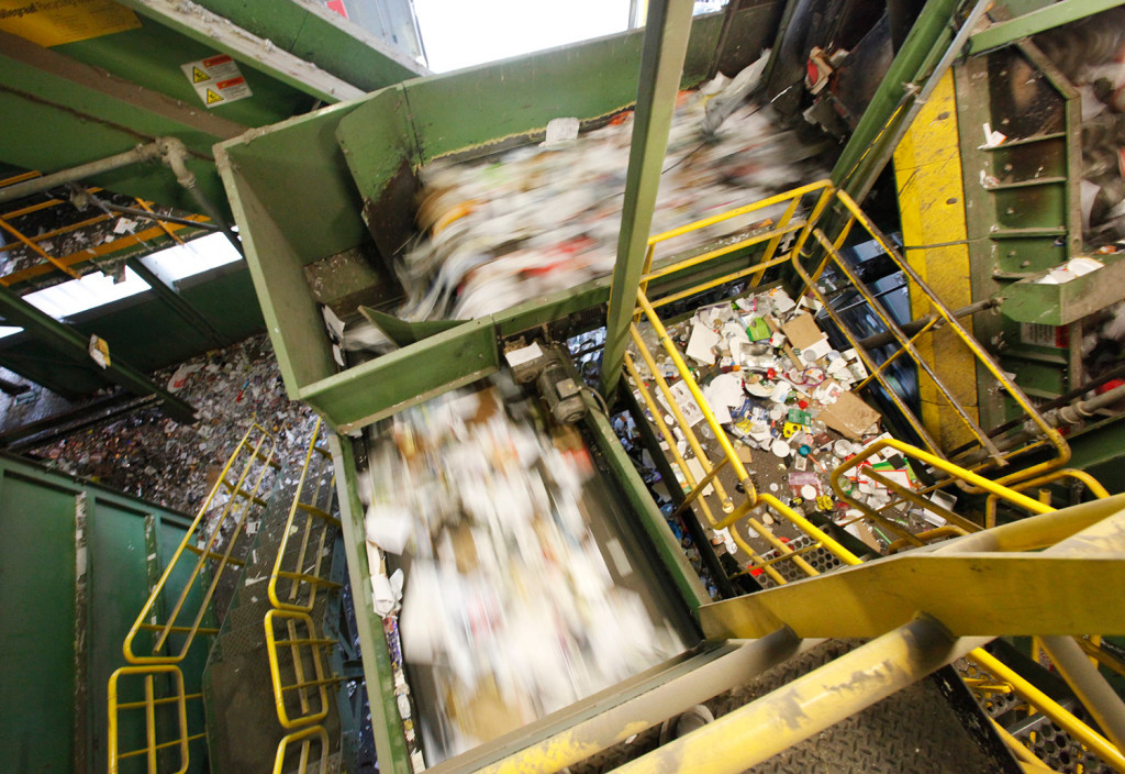 A conveyor belt carries recyclable materials to be sorted at ecomaine.