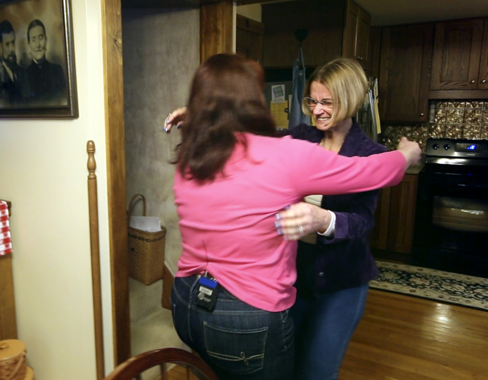 Linda Deming, right, and Amber McIntyre meet for the first time at Deming's home in Pownal on Monday night. A transplant scheduled for Tuesday will culminate Deming's search for a kidney donor.