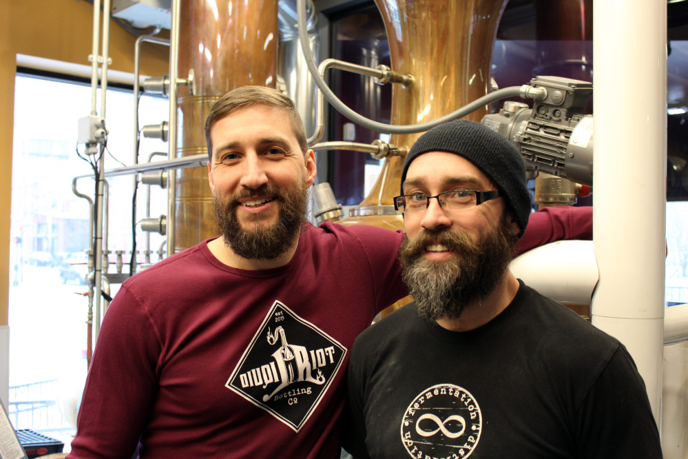 Eric Michaud, left, and brother Ian Michaud operate Liquid Riot Bottling Company in Portland.
