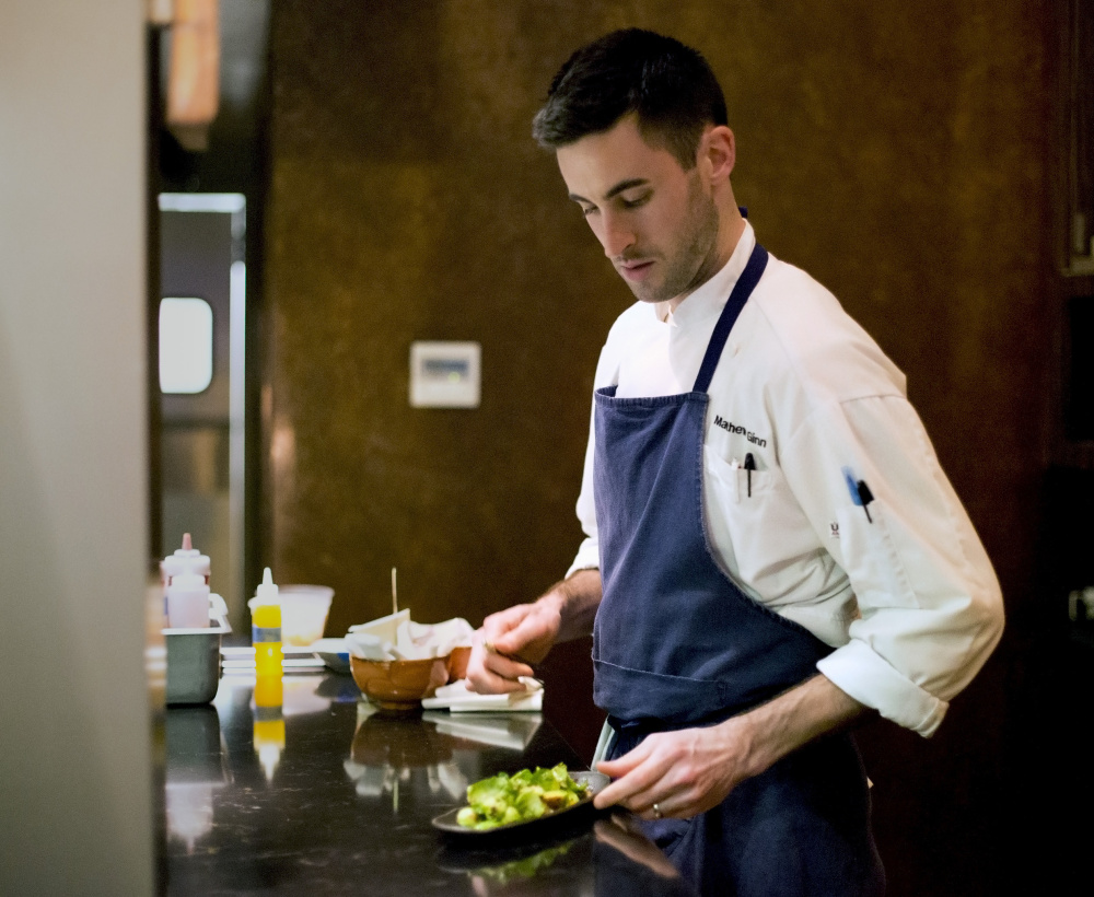 Matthew Ginn, the chef at Evo, makes final preparations before sending dishes to be served at the restaurant.