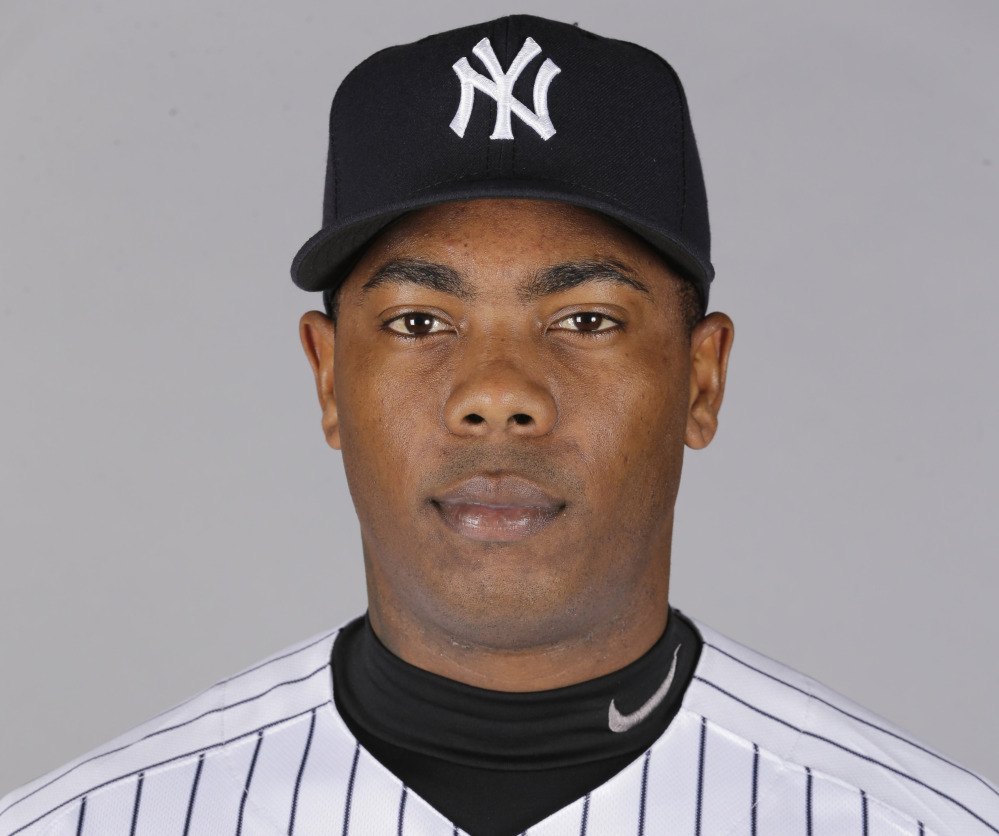 Aroldis Chapman agreed to accept a 30-game suspension under Major League Baseball's domestic violence policy, a penalty stemming from an incident with his girlfriend last October. Under the discipline announced Tuesday, Chapman will serve the penalty from the start of the season in April. (AP Photo/Chris O'Meara, File)