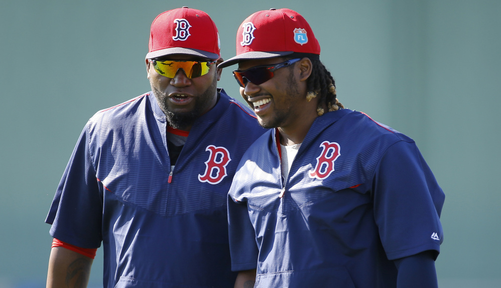 David Ortiz, left, has been a first baseman as well as a designated hitter for years. Now Hanley Ramirez gets his chance at first base and the thing is, it's not a question how much there is to learn but his willingness to learn it.