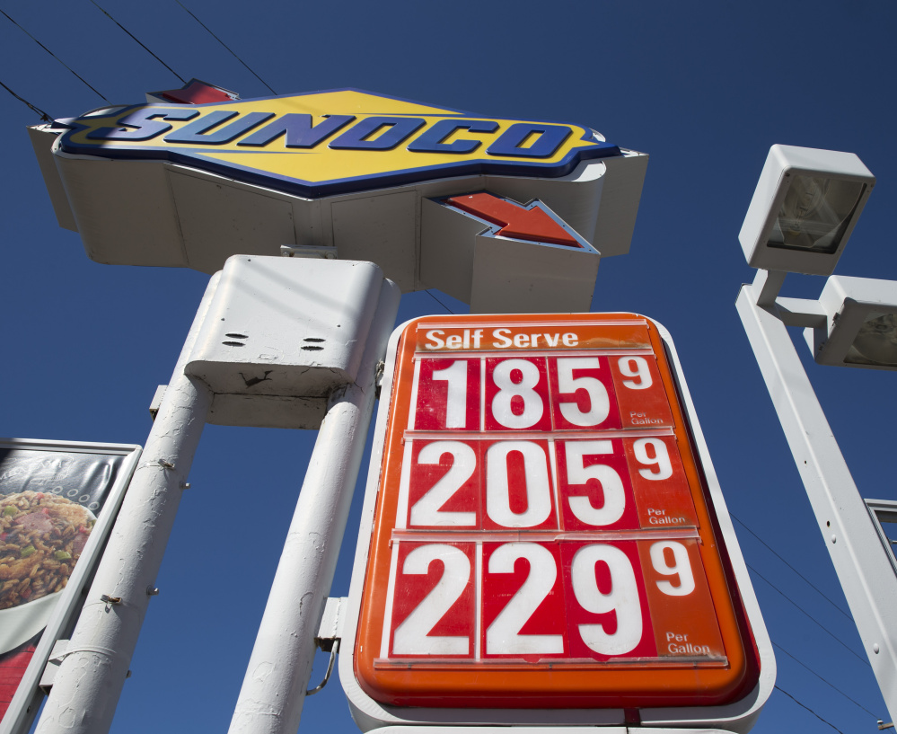 Gas prices are posted at a filling station Wednesday in Philadelphia. The national average price has risen for eight straight days – the first time that has occurred since last May.